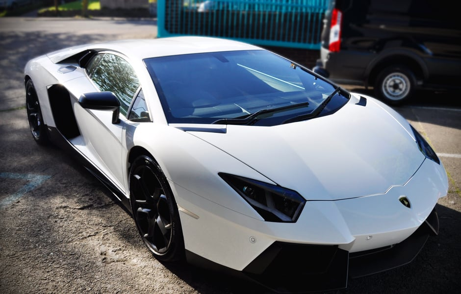 Satin Black detailing on sides, rear and front of a Lamborghini Aventador using 3M™ 1080 Series